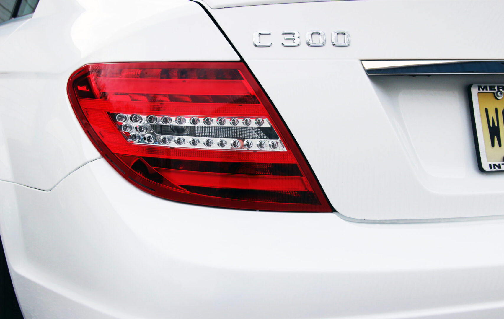 """White Pearl Mercedes Benz C300 with rear bumper and left rear tail lamp damage restored to """"like-new"""" conditions by Hackettstown NJ auto body shop and collision repair specialist, Dales Custom Auto."""